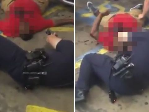 New footage shows police taking gun from Alton Sterling's body