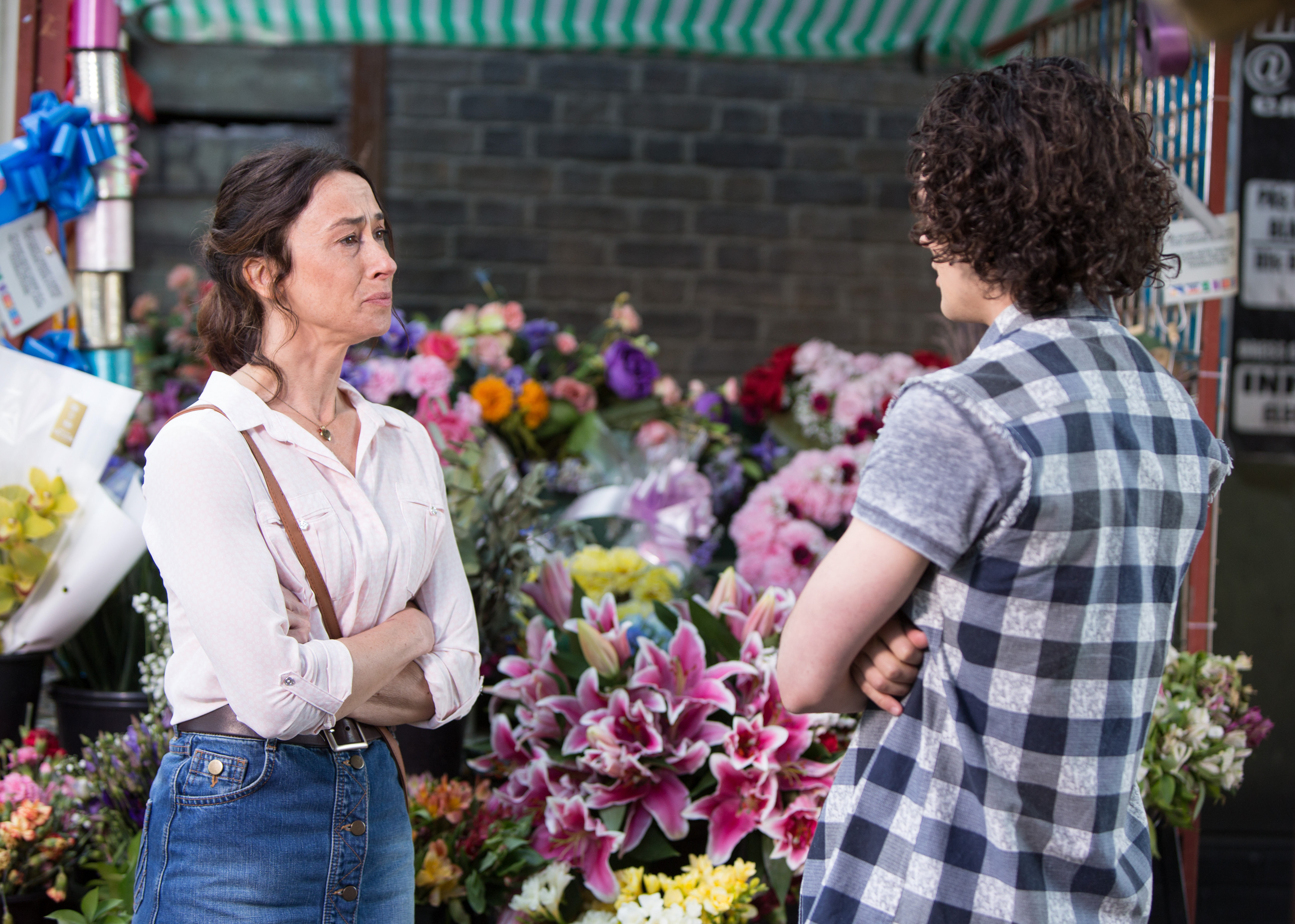 WARNING: Embargoed for publication until 00:00:01 on 05/07/2016 - Programme Name: EastEnders - July - September 2016 - TX: 12/07/2016 - Episode: EastEnders July - September  2016 - 5314 (No. n/a) - Picture Shows: *STRICTLY NOT FOR PUBLICATION UNTIL 00:01HRS, TUESDAY 5th JULY, 2016* ***FORTNIGHTLIES PLEASE DO NOT USE (SOAP LIFE AND ALL ABOUT SOAP) Jenny approaches Paul but bursts into tears when he speaks to her, overwhelmed. Jenny Rawlinson (AMY MARSTON), Paul Coker (JONNY LABEY) - (C) BBC - Photographer: Kieron McCarron