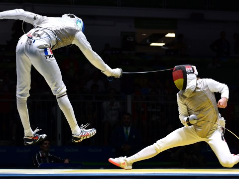A mobile phone fell out of this fencer's pocket in the middle of a bout at the Rio Olympics