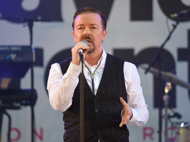 "LONDON, ENGLAND - AUGUST 10: Ricky Gervais and the Foregone Conclusion perform at the World premiere of ""David Brent: Life On The Road"" at Odeon Leicester Square on August 10, 2016 in London, England. (Photo by Karwai Tang/WireImage)"