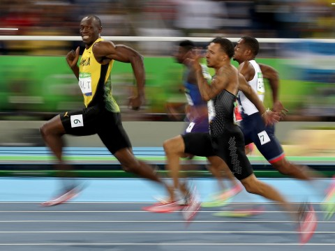 Usain Bolt literally posed for a photo half-way through his 100m Olympic semi-final last night