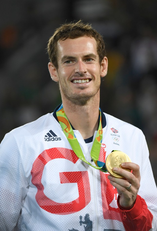 RIO DE JANEIRO, BRAZIL - AUGUST 14: Andy Murray of Great Britain celebrates with the gold medal after the Men's Singles Gold Medal Match on Day 9 of the Rio 2016 Olympic Games at the Olympic Tennis Centre on August 14, 2016 in Rio de Janeiro, Brazil. (Photo by Bob Thomas/Popperfoto/Getty Images).