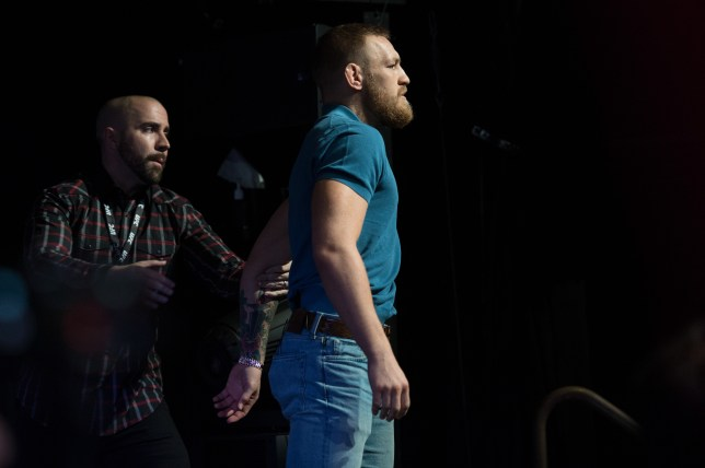 LAS VEGAS, NV - AUGUST 17: UFC featherweight champion Conor McGregor is held back by the UFC VP of Public Relations Dave Sholler during the UFC 202 Press Conference at David Copperfield Theater in the MGM Grand Hotel/Casino on August 17, 2016 in Las Vegas, Nevada. (Photo by Brandon Magnus/Zuffa LLC/Zuffa LLC via Getty Images)