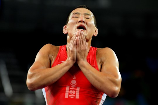 RIO DE JANEIRO, BRAZIL - AUGUST 21: Mandakhnaran Ganzorig (red) of Mongolia reacts following his defeat to Ikhtiyor Navruzov (blue) of Uzbekistan in the Men's Freestyle 65kg Bronze match against on Day 16 of the Rio 2016 Olympic Games at Carioca Arena 2 on August 21, 2016 in Rio de Janeiro, Brazil. (Photo by Laurence Griffiths/Getty Images)