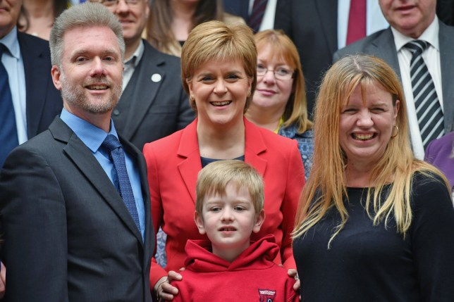EDINBURGH, SCOTLAND - MAY 26: Gregg, Kathryn and Lachlan Brain meet Scotland's First Minister Nicola Sturgeon at the Scottish Parliament garden lobby on May 26, 2016 in Edinburgh, Scotland. and Kathryn Brain, an Australian couple with Scottish ancestry, and their seven year old son Lachlan are facing deportation after the visa they arrived on was retrospectively cancelled by the Home Office. They arrived in 2011 under The Highland Homecoming Initiative run by the Scottish Government and backed by the Home Office to help re-populate the Highlands but the scheme was shut by the Home Office in 2012. The Brain family have settled in Dingwall where Lachlan is a pupil at the local Gaelic-speaking primary school. Their community, councillors and MSP's have rallied round in support of their bid to stay in the Highlands. .(Photo by Jeff J Mitchell/Getty Images)
