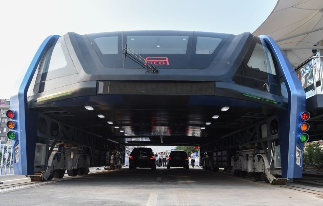 Mandatory Credit: Photo by Xinhua/REX/Shutterstock (5814504h) The transit elevated bus TEB-1 is on road test in Qinhuangdao, north China's Hebei Province Elevated bus TEB-1 road test, Qinhuangdao, China - 02 Aug 2016 China's home-made transit elevated bus, TEB-1, conducted a road test running Tuesday. The 22-meter-long, 7.8-meter-wide and 4.8-meter-high TEB-1 can carry up to 300 passengers. The passenger compartment of this futuristic public bus rises far above other vehicles on the road, allowing cars to pass underneath