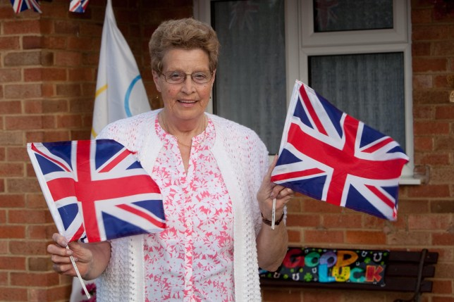 Mavis Williams (74) from Uttoxeter, Staffordshire, who is the nan to Adam Peaty, Britain's first gold medal winner at 2016 Rio Olympics, celebrates outside her bungalow after staying up overnight to see her grandson swim to victory. Great Britain won their first medal of Rio 2016 as Adam Peaty took gold in the men's 100m breaststroke with a world record. See NTI story NTIPEATY. The 21-year-old from Uttoxeter, Staffs, broke his own world record by winning in 57.13 seconds, well clear of the field. Peaty is the first British man to win an Olympic swimming gold medal since Adrian Moorhouse, who won the same event in Seoul in 1988. Welsh star Jazz Carlin won silver in the women's 400m freestyle soon after.