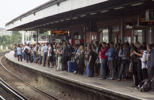 Mandatory Credit: Photo by Amer Ghazzal/REX/Shutterstock (5826141c) Commuters wait to board Southern rail trains at Clapham Junction station on the second day of the RMT strike Southern Rail strike action, London, UK - 09 Aug 2016