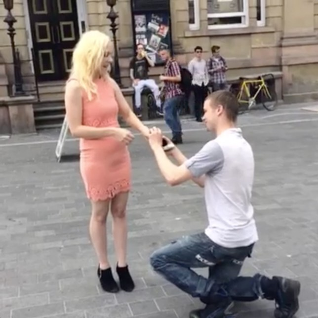 Pic by HotSpot Media - MAN PROPOSES TO GIRLFRIEND AFTER FACEBOOK LIKES CHALLENGE - IN PIC - Hannah Tolley, 25, and Rhys Green, 23, pictured during Rhys' proposal - which they livestreamed on Facebook. - A couple have got engaged after the bride-to-be's boyfriend set her a Facebook 'likes' challenge.¬¿Rhys Green, 23, told his girlfriend of seven months, Hannah Tolley, 25, that if 489 people 'liked' her Facebook post, he would propose.¬¿Further terms included Hannah amassing 499 comments and 500 shares.¬¿With the help of Facebook users from around the world, full-time mum-of-one Hannah smashed her target and Rhys - who says he felt a 'moral obligation' to honour the challenge - promptly proposed.¬¿Now the Kidderminster couple are busy planning their wedding, which they plan to livestream on Facebook as a way to thank everyone who 'liked' their post...SEE HOTSPOT MEDIA COPY 0121 551 1004