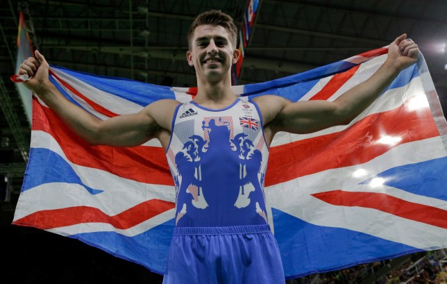 Britain's Max Whitlock celebrates with his national flag after winning the gold medal for the floor exercise during the artistic gymnastics men's apparatus final at the 2016 Summer Olympics in Rio de Janeiro, Brazil, Sunday, Aug. 14, 2016. (AP Photo/Dmitri Lovetsky)