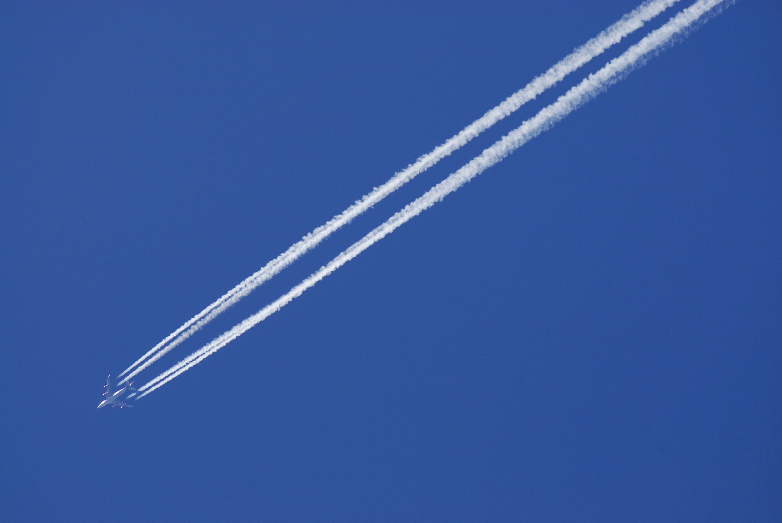 vapor trails or chemtrails from jets in sky often forming grid or triangular patterns. (Photo by Photofusion/Universal Images Group via Getty Images)