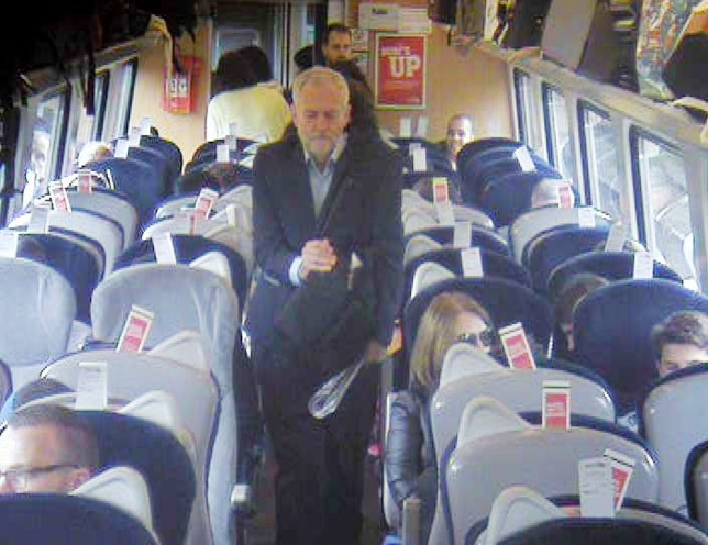 """Handout CCTV footage dated 11/08/16 issued by Virgin Trains which was filmed at 11.08am, approximately 8 min after departure from Kingís Cross in central London, showing Labour Party leaderJeremy Corbyn, walking past several empty, unreserved seats in Coach F, after a video emerged last week which showed Mr Corbyn sitting on the floor, reading a newspaper, and saying """"This is a problem that many passengers face every day"""" before calling for public ownership of the railways. PRESS ASSOCIATION Photo. Issue date: Tuesday August 23, 2016. The Labour leader was travelling on the three-hour Virgin Trains service from London to Newcastle on August 11. Virgin Trains released the CCTV images which appear to show him and his team walking past empty, unreserved seats before the filming began. See PA story RAIL Corbyn. Photo credit should read: Virgin Trains/PA Wire NOTE TO EDITORS: This handout photo may only be used in for editorial reporting purposes for the contemporaneous illustration of events, things or the people in the image or facts mentioned in the caption. Reuse of the picture may require further permission from the copyright holder."""