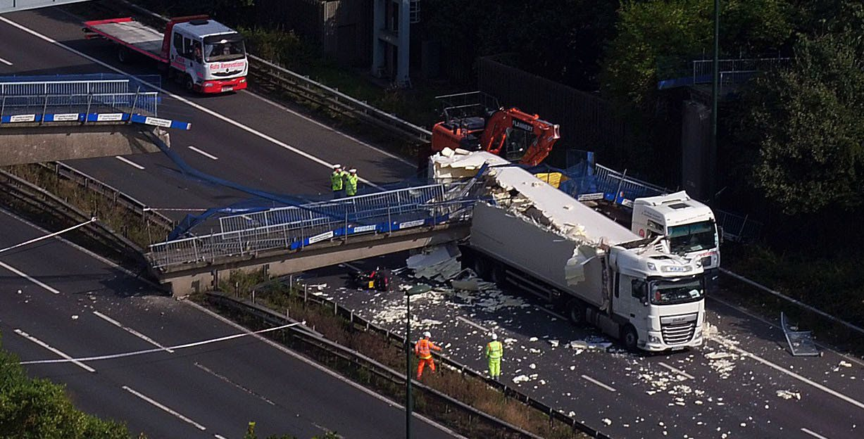 The scene on the M20 motorway after a lorry hit a motorway bridge, causing it to collapse. PRESS ASSOCIATION Photo. Picture date: Saturday August 27, 2016. Emergency services have declared a major incident after a lorry hit a motorway bridge, causing it to collapse on one of the busiest travel days of the year. See PA story ACCIDENT BankHoliday. Photo credit should read: Steve Parsons/PA Wire