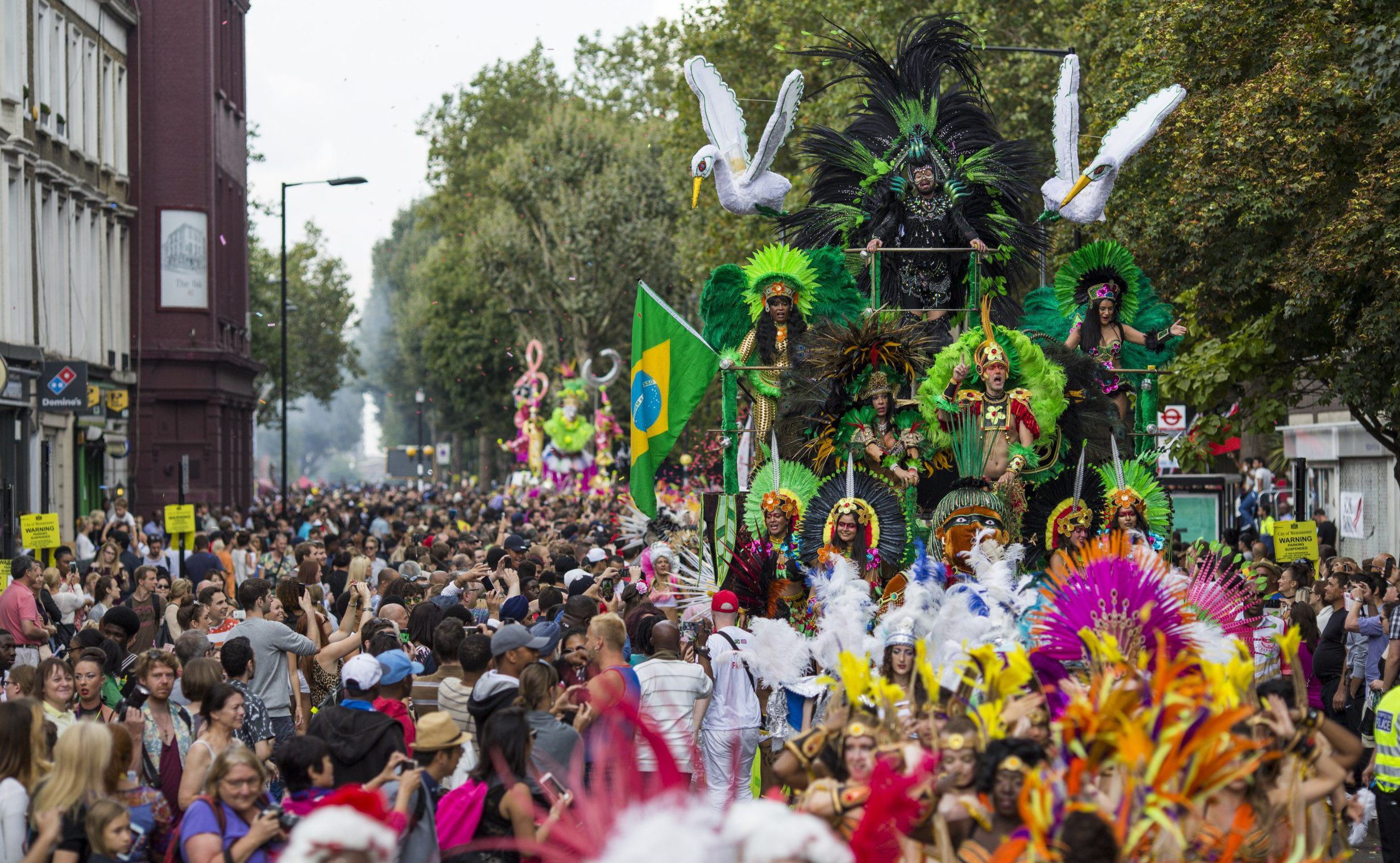LONDON, ENGLAND - AUGUST 29: Performers on a float take part in the Notting Hill Carnival on August 29, 2016 in London, England. The Notting Hill Carnival, which has taken place annually since 1964, is expected to attract over a million people. The two-day event, started by members of the Afro-Caribbean community, sees costumed performers take to the streets in a parade and dozens of sound systems set up around the Notting Hill streets. (Photo by Jack Taylor/Getty Images)