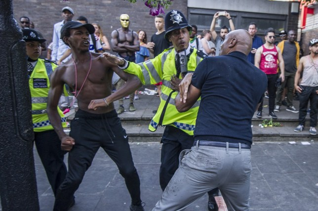 A fight breaks out at the annual Notting Hill Carnival in London Featuring: Atmosphere Where: London, United Kingdom When: 29 Aug 2016 Credit: Euan Cherry/WENN.com