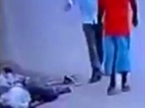 Hundreds of people ignore man dying in the street after hit-and-run