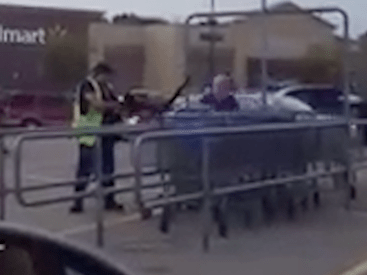 Monkey wearing nappy gets into a scrap with shop worker in car park