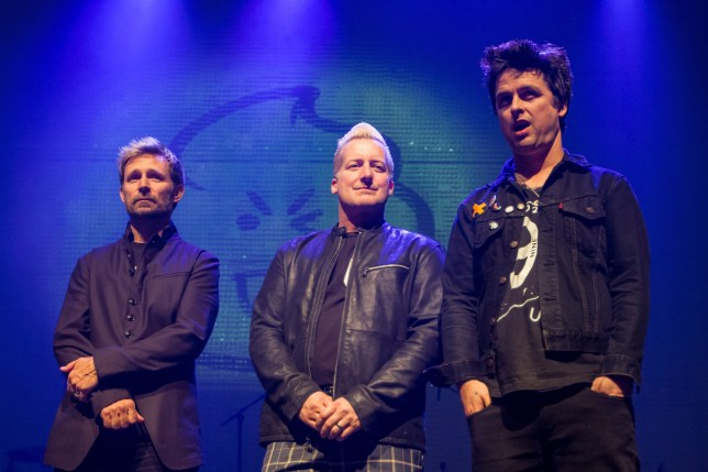 Green Day (Bassist Mike Dirnt, drummer Tre Cool and vocalist Billie Joe Armstrong) have been forced to postpone tour dates due to illness (Picture: Miikka Skaffari/FilmMagic)