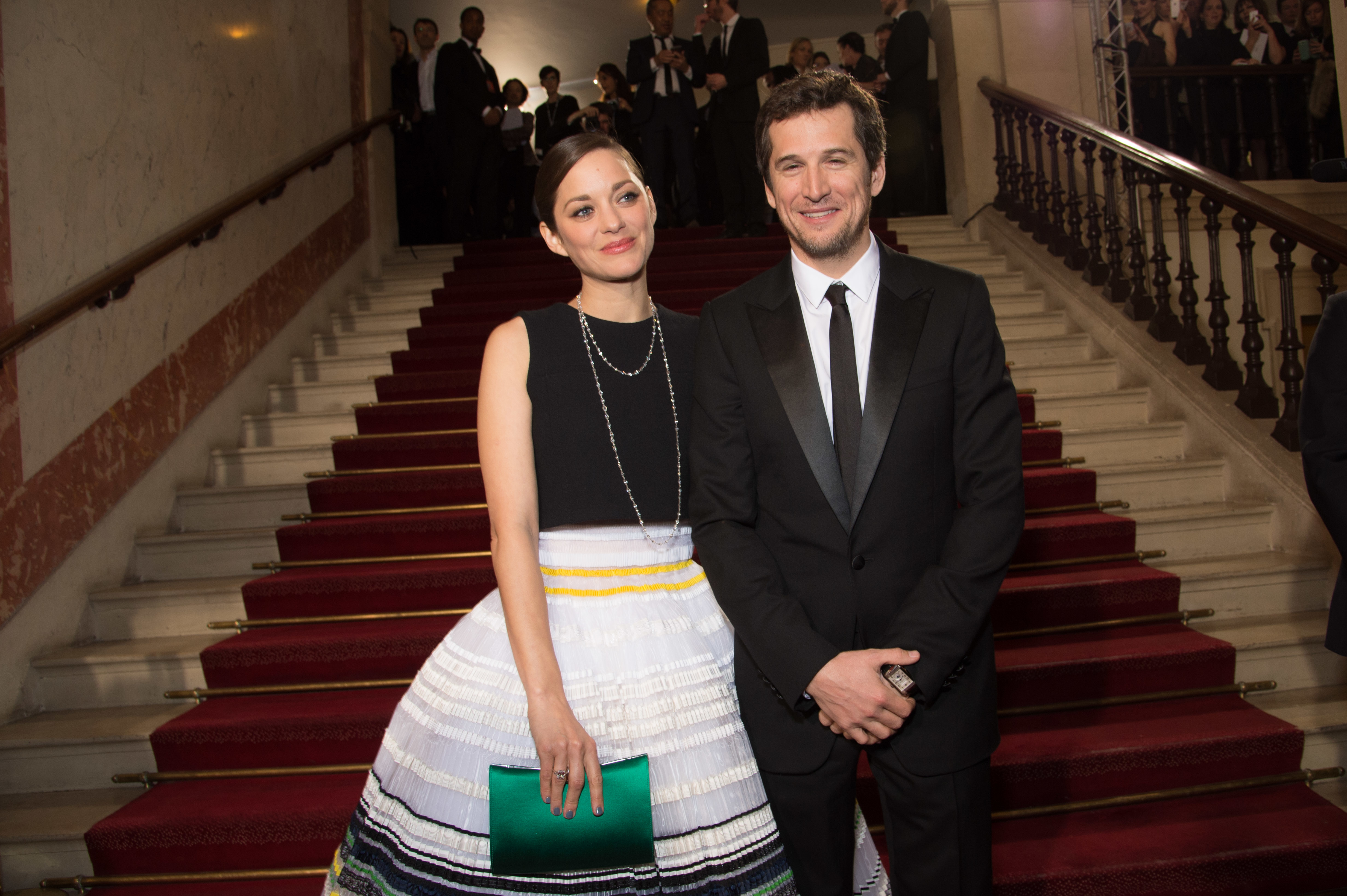 (L-R) Marion Cotillard and Guillaume Canet arrive at the 40th Cesar Film Awards 2015 Cocktail at Theatre du Chatelet on February 20, 2015 in Paris, France. (Photo by Stephane Cardinale/Corbis via Getty Images)