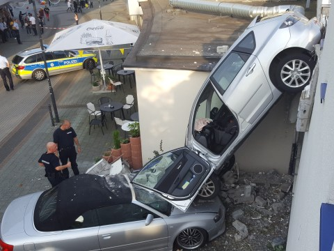 Woman drives straight out of a multistory car park (literally)