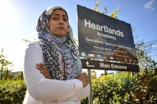 PIC BY KORAY EROL/ CATERS NEWS - (PICTURED: Suriyah Bi outside the Heartlands Academy) -A Muslim teacher is taking legal action against the school she claims sacked her for complaining about an X-rated video of the 9/11 horrors shown to children. Suriyah Bi lost her job at Birminghams Heartlands Academy after just a week and is now pursuing claims for unfair dismissal and religious discrimination.Suriyah, from Yardley , made national headlines last September after complaining she was sacked for objecting to a class of 11-year-olds being shown the footage. The organisation says it will oppose Suriyahs claims, and says the 24-year-old simply no longer wanted to work at the school. SEE CATERS COPY