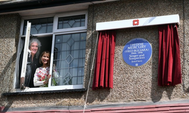 FELTHAM, ENGLAND - SEPTEMBER 01: Brian May and Kashmira Cooke (Freddie Mercury's sister) attend the unveiling of an English Heritage Blue Plaque, commemorating where Freddie Mercury lived on September 1, 2016 in Feltham, England. (Photo by Stuart C. Wilson/Getty Images)