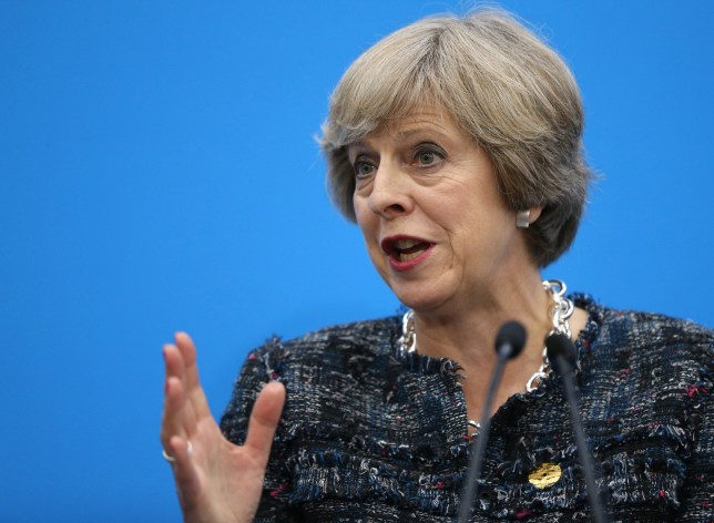 epa05525338 British Prime Minister Theresa May speaks to reporters during a press conference after the G20 Summit at the Hangzhou International Expo Centre in Hangzhou, China, 05 September 2016. EPA/HOW HWEE YOUNG