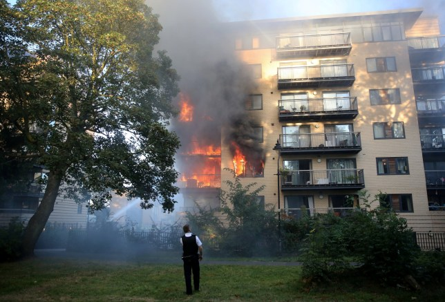 10 fire engines and over 50 firefighters are tackling a flat blaze on Hicken Road in Brixton, London, September 7 2016. See National News story.
