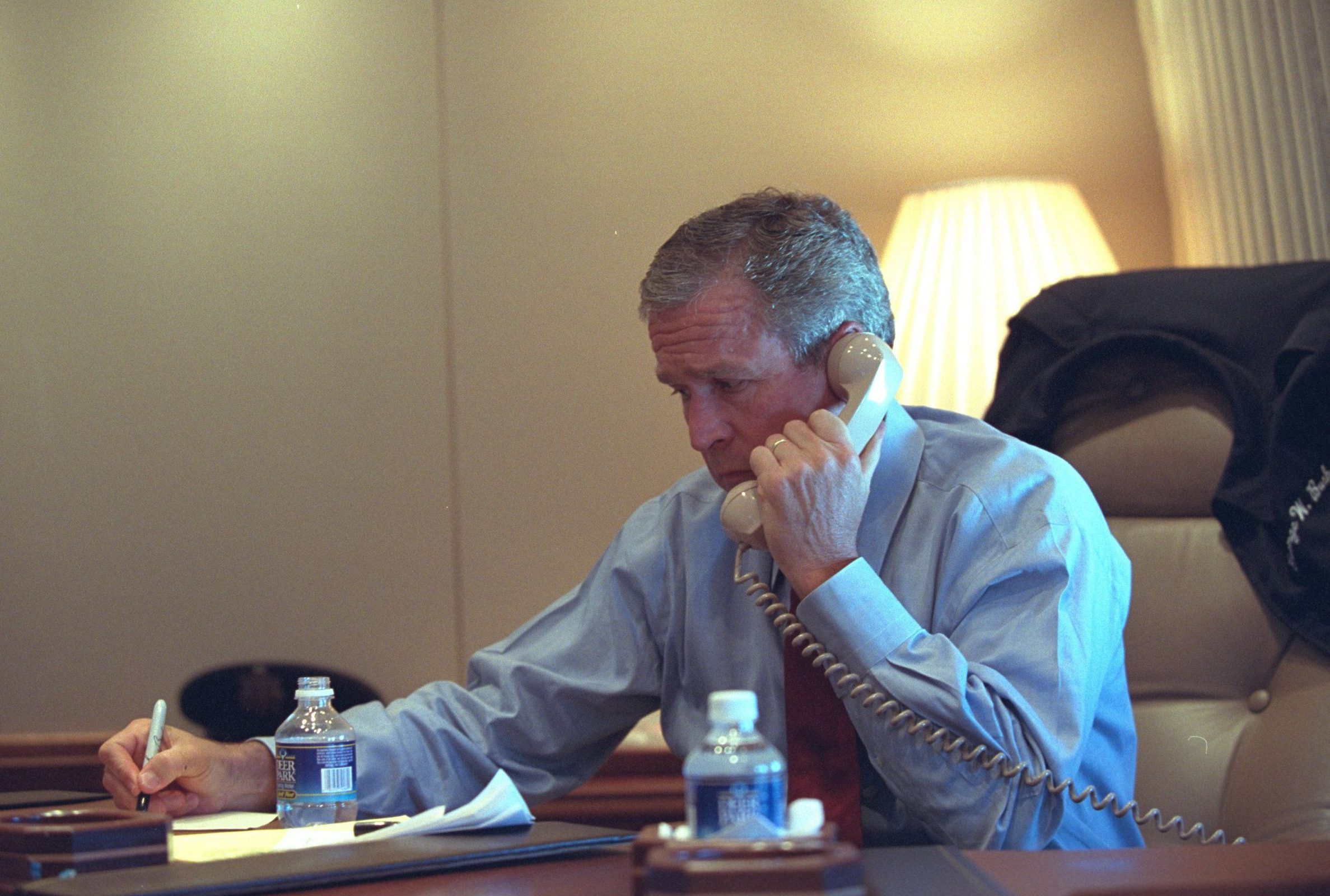 Please use individual photographer credits/George W. Bush Presidential Library/Rex Shutterstock. Editorial use onlynMandatory Credit: Photo by Eric Draper/G. W. Bush Pres./REX/Shutterstock (5701155n)nPresident George W. Bush confers with staff via telephone Tuesday, Sept. 11, 2001, from his office aboard Air Force One during the flight from Sarasota to Barksdale Air Force Basen9/11: A Presidential reaction, America - 11 Sep 2001nOn September 11, 2001, terrorists attacked the United States. Over the next 50 days and nearly 50,000 images later, White House photographers would capture the horror and heroism, the courage and compassion surrounding those attacks. From a Florida second-grade classroom to a ceremonial first pitch, these moments in time reflect the resounding resolution and resiliency of a president.nnPresident George W. Bush began his schedule that day at the Emma E. Booker Elementary School in Sarasota, Florida. Participating in a second-grade reading demonstration, he was informed by his Chief of Staff that America is under attack. As events unfolded in New York City, Washington, DC, and Pennsylvania, President Bush directed the nations response from Air Force One as he flew from Sarasota to Barksdale Air Force Base to Offutt Air Force Base and returned to Washington, DC, where he addressed the nation from the Oval Office.n