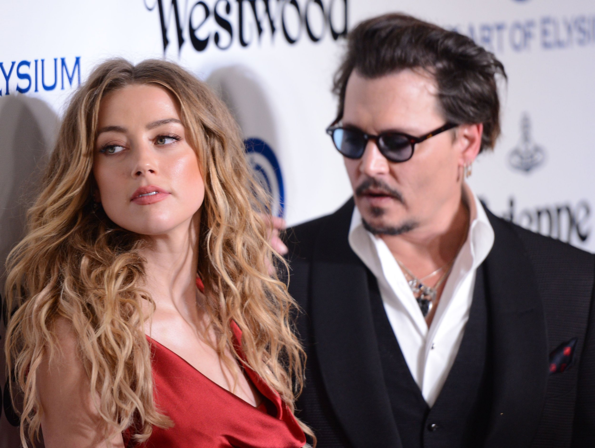 Amber Heard and Johnny Depp's friend opens up about what it was like to live with couple for a year