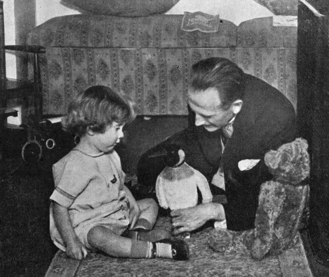 CANNOT BE USED AFTER 17/12/16. EDITORIAL USE ONLY. Undated handout photo issued by Egmont Publishing of A. A. Milne (right) and Christopher Robin Milne playing with a toy teddy bear as a new Winnie-the-Pooh character, inspired by the photograph, has been unveiled. PRESS ASSOCIATION Photo. Issue date: Sunday September 18, 2016. A new adventure, The Best Bear In All The World, is being published in October to mark the 90th anniversary of the publication of Winnie-the-Pooh. See PA story SHOWBIZ Pooh. Photo credit should read: Culture Club/Egmont Publishing/PA Wire NOTE TO EDITORS: This handout photo may only be used in for editorial reporting purposes for the contemporaneous illustration of events, things or the people in the image or facts mentioned in the caption. Reuse of the picture may require further permission from the copyright holder.