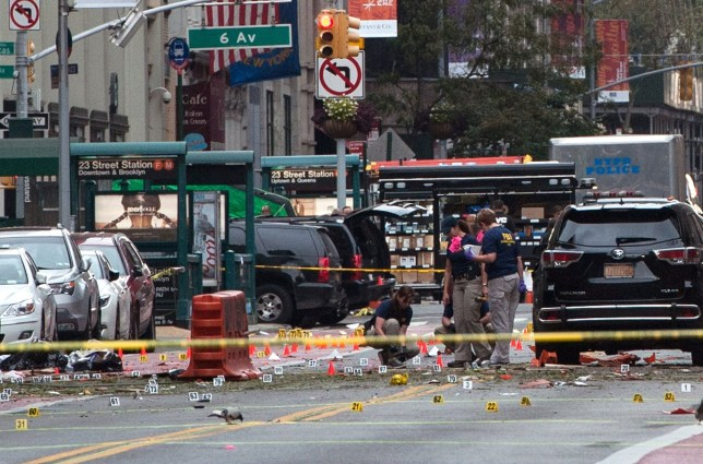"""NEW YORK, NY - SEPTEMBER 18: FBI agents review the crime scene of remnants of bomb debris on 23rd St. in Manhattan's Chelsea neighborhood on September 18, 2016 in New York City. An explosion that injured 29 people that went off in a construction dumpster is being labeled an """"intentional act"""". A second device, a pressure cooker, was found four blocks away that an early investigation found was likely also a bomb. (Photo by Stephanie Keith/Getty Images) *** BESTPIX ***"""