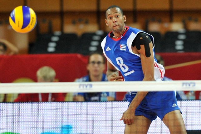 Cuba volleyball team rape WROCLAW, POLAND - SEPTEMBER 10: Rolando Cepeda Abreu of Cuba serves the ball during the FIVB World Championships match between Cuba and Canada on September 10, 2014 in Wroclaw, Poland. (Photo by Piotr Hawalej/Getty Images for FIVB)