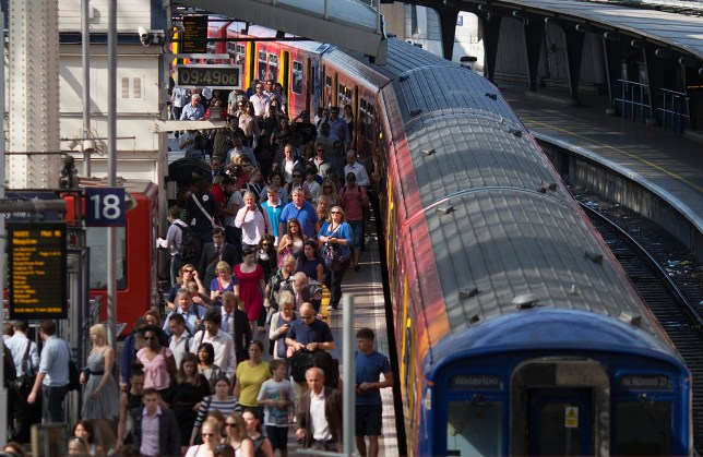 Commuters walk along a platform after exiting a passenger train operated by South West Trains Ltd. at Waterloo rail station in London, U.K., on Tuesday, July 9, 2013. U.K. Prime Minister David Cameron is committed to the building of a high-speed rail line linking London to northern England, his spokesman said as evidence mounts that all-party support for the project is fracturing. Photographer: Simon Dawson/Bloomberg via Getty Images