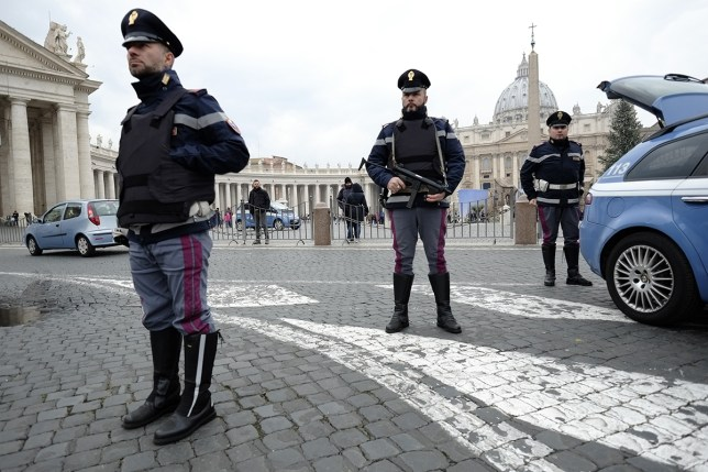 """pic- getty Italian policemen stand guard near the Vatican on January 8, 2015 in Rome. Italy called a meeting of its """"anti-terrorism"""" committee yesterday to examine possible threats following an attack on the offices of French satirical newspaper Charlie Hebdo that killed 12 people. The Strategic Anti-terrorism Analysis Committee, """"made up of experts in anti-terrorism from the police force and intelligence services, will closely examine the terrorist threat in light of the grave attack,"""" the interior ministry said in a statement. AFP PHOTO / ANDREAS SOLARO (Photo credit should read ANDREAS SOLARO/AFP/Getty Images)"""