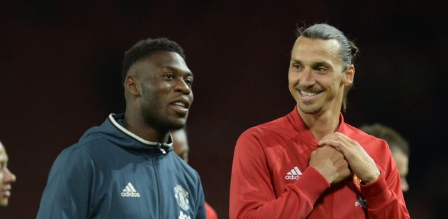 Manchester United's Swedish striker Zlatan Ibrahimovic (R) talks with Manchester United's Dutch defender Timothy Fosu-Mensah (L) at the end of the friendly Wayne Rooney testimonial football match between Manchester United and Everton at Old Trafford in Manchester, northwest England, on August 3, 2016. / AFP / OLI SCARFF (Photo credit should read OLI SCARFF/AFP/Getty Images)