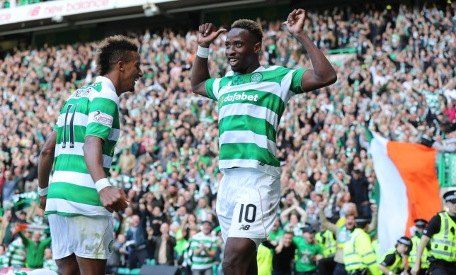 GLASGOW , SCOTLAND - SEPTEMBER 10: Moussa Dembele of Celtic celebrates his goal ( Celtics 2nd)with Scott Sinclair Rangers during the Ladbrokes Scottish Premiership match between Celtic and Rangers on September 10, 2016 in Glasgow. (Photo by Steve Welsh/Getty Images)