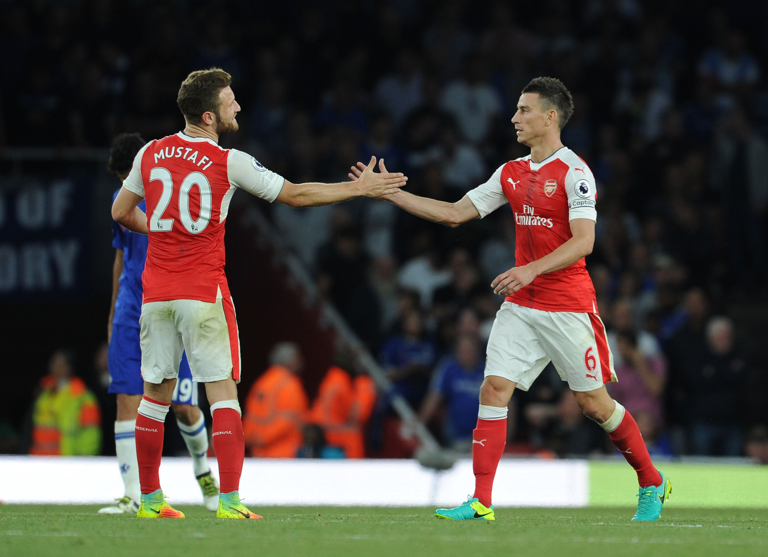How does the Mustafi and Koscielny centre-back pairing compare with Arsenal's title rivals?