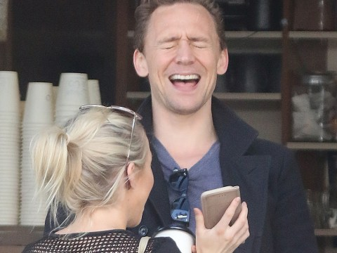 Tom Hiddleston chats up mystery blonde outside Australian coffee shop