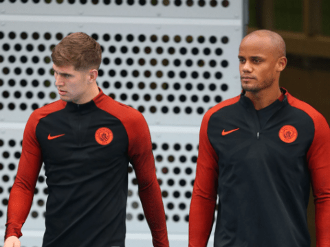 Manchester City fans are delighted to see Vincent Kompany and John Stones starting against Swansea