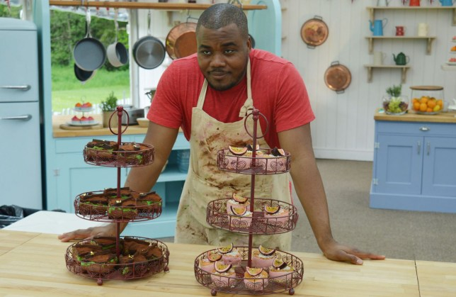 Great British Bake Off's Selasi Gbormittah in the kitchen with baked goods in front of him