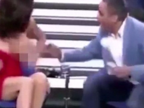 Spanish TV host exposes guest's breast on live show
