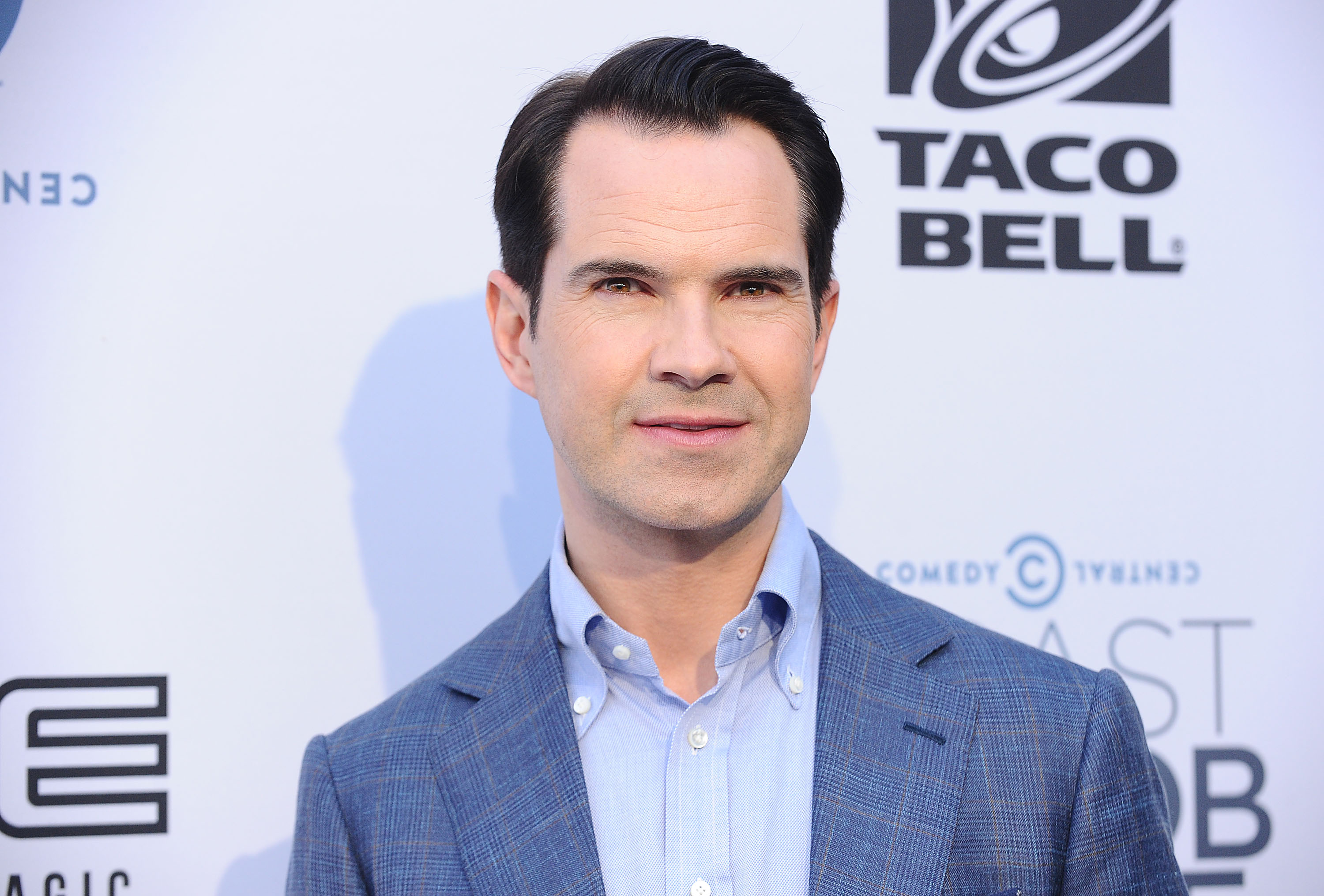 Funny man Jimmy Carr has reportedly worked on the new Robbie Williams and Kylie Minogue duet (Picture: Jason LaVeris/FilmMagic/Getty Images)