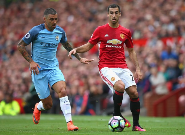 MANCHESTER, ENGLAND - SEPTEMBER 10: Henrikh Mkhitaryan of Manchester United (R) takes the ball past Aleksander Kolorov of Manchester City (L) during the Premier League match between Manchester United and Manchester City at Old Trafford on September 10, 2016 in Manchester, England.  (Photo by Alex Livesey/Getty Images)