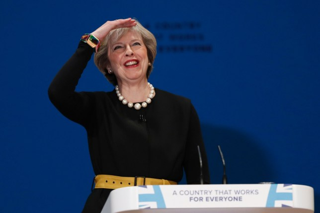 Britain's Prime Minister Theresa May gestures as she delivers a speech on the first day of the Conservative party annual conference at the International Convention Centre in Birmingham, central England, on October 2, 2016. Britain's governing Conservative Party meets for its annual conference from Sunday facing questions over how and when it will take the country out of the European Union following the Brexit vote. / AFP PHOTO / Adrian DENNISADRIAN DENNIS/AFP/Getty Images