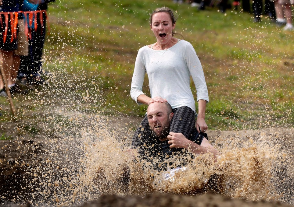 Peter Ver Ploeg carries Virginia Petrovek through the mud pit during the North American Wife Carrying Championship, Saturday, Oct. 8, 2016, at the Sunday River Ski Resort in Newry, Maine. The couple, from Portland, Maine, has been married for one year. (AP Photo/Robert F. Bukaty)