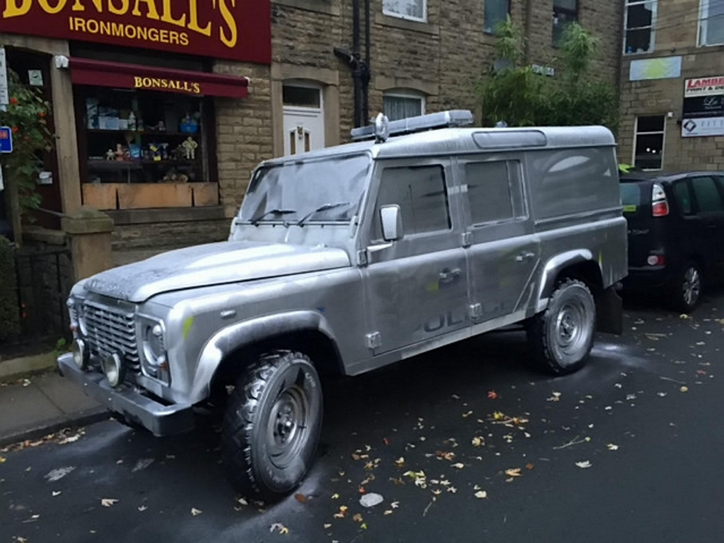 """A police Land Rover that has been spray painted silver. Police in Hebden Bridge, Yorkshire, are appealing for information following a criminal damage incident. Sometime between 9.30pm last night (10th October) and 4.45am this morning on Royd Villas where a Police Land Rover was painted silver. See ROSS PARRY story RPYSILVER. Neighbourhood Inspector John Simpson said: """"Some people might find this funny but the extent of the damage means that this vital emergency vehicle will be off the road whilst it is repaired at a cost. It is a specialist vehicle used to access the more rural areas of Calderdale and as such is an essential vehicle for the local communities."""" ø"""