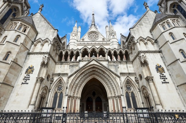 The front entrance to The Royal Courts of Justice is pictured on The Strand in central London on August 21, 2016. The Royal Court of Justice building accommodates both the Court of Appeal and the High Court. Often referred to as The Law Courts, the building was designed by architect George Edmund Street in Gothic style and opened by Queen Victoria in 1882 / AFP / NIKLAS HALLE'N (Photo credit should read NIKLAS HALLE'N/AFP/Getty Images)