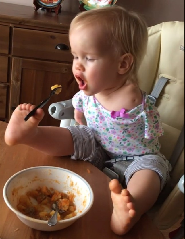 Girl with no arms who has taught herself to eat with her feet. credit: Elmira Knutzen/Facebook https://www.facebook.com/elmira.knutzen/videos/10154406233776265/