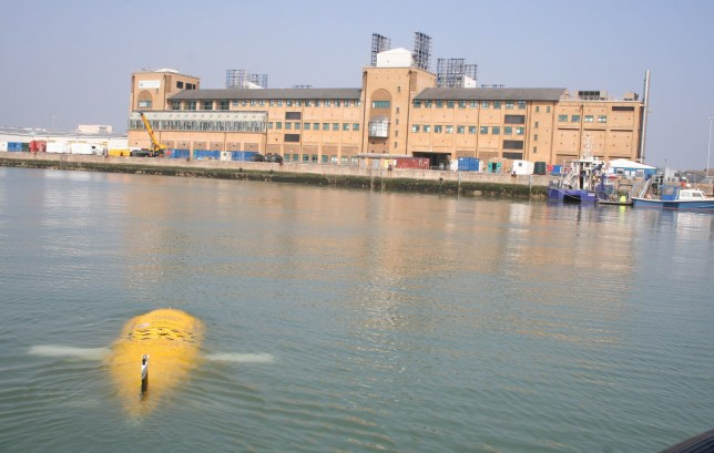 Pictured: Boaty McBoatface in the water with the National Oceanography Centre in the background. Southampton becomes the home of ëBoaty McBoatfaceí A new yellow robot submarine, based at Southamptonís National Oceanography Centre (NOC), has been named Boaty McBoatface by Jo Johnson ñ Minister of State for Universities, Science, Research and Innovation. The naming took place alongside the keel-laying ceremony of the UKís new state-of-the-art polar research ship, RRS Sir David Attenborough, at Cammell Lairdís shipyard in Birkenhead. Boaty McBoatface and RRS Sir David Attenboroughís missions are set to be the focal point of a new £1M Government-funded ëPolar Explorer Programmeí, that aims to inspire the next generation of scientists, engineers and citizens by engaging young people with the RRS Sir David Attenborough and polar science.  © NOC/Solent News & Photo Agency UK +44 (0) 2380 458800